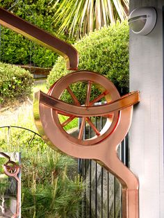 Water wheel copper downspout - so cool!!