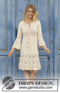 Love Story - Knitted dress with lace pattern and ¾ sleeves. Size: S - XXXL Piece is knitted in DROPS Paris. - Free pattern by DROPS Design