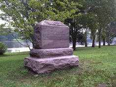 Historic stone marker where General George Washington crossed the Delaware River to Trenton, New Jersey on Christmas Eve 1776 during the American War of Independance.  Washington Crossing State Park, Upper Makefield, Pennsylvania.