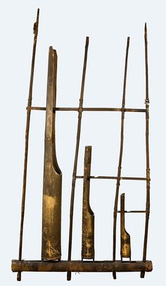Angklung, Java, 20th century. Three bamboo-tube rattles set in a wooden frame. Sound produced when frame is shaken and tubes slide back and forth. Tongue segments cut from the tops of the tubes determine the pitch. Although the angklung is widely distributed across Southeast Asia, it is most prominent in Java. Traditionally played in ensembles with additional angklungs tuned to different pitches.
