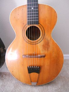 1914 The Gibson L-1 Acoustic... sweet mother theresa on the hood of a mercedes benz
