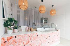 Design by Jessica de Velasco / Photography by Amanda Julca Flamingo wallpaper-lined custom countertop, pendant shades