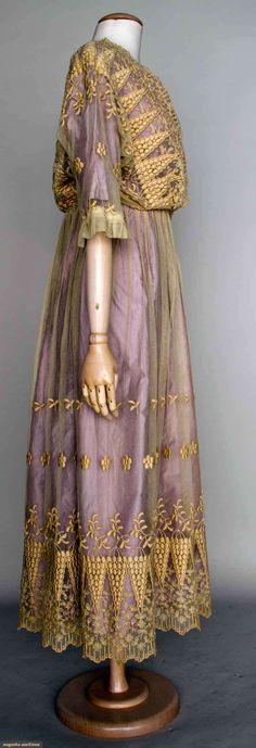 EMBROIDERED TEA GOWN, 1914-1918 Cream cotton net, floral embroidery, lilac underdress. Sideway