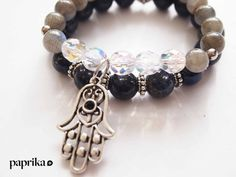 Hamsa- is a sign of protection that also represents blessings, power and strength. The hamsa is believed to provide defense against the evil eye.