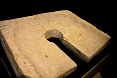 Limestone toilet seat found in a royal palace in Amarna (Akhet-Aten). 18th dynasty ancient Egypt. Cairo museum.