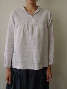 The blouse with small shawl collar.  Arm hole and bodice are not very tight, and it can go nicely as a layer on turtle necked sweater in winter