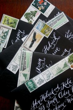 Love*Jenna calligraphy on wedding invite envelopes with vintage stamps