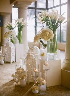 All-white #wedding ceremony decor with calla lilies | Brides.com.. I like the white cages