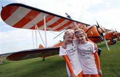 Nine-year-old cousins Rose Brewer, left, and Flame Brewer prepare before their attempt to become the world's youngest formation wing walkers. >>>>HAVE FRIENDS IN ARIZONA? Tell them we'd love them to visit our restaurant, the LEFT SEAT WEST, an AVIATION THEMED RESTAURANT in Glendale, Arizona!  Check out our Facebook page! http://www.facebook.com/pages/Left-Seat-West-Restaurant/192309664138462