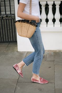 Emma Hill wears pink velvet loafers, raw hem jeans, basic white t-shirt, straw basket bag with pom poms