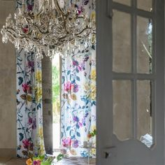 Couture Rose Linen Fabric An exquisite fabric with a large scale design of yellow, fuchsia and white roses applied with a painterly effect onto an ivory linen ground.