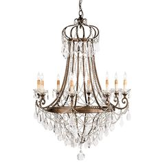 This Eastern European influenced design features a crown element at the top. The large-scale eight light chandelier is heavily laden with a variety of crystal ornamentation. The wrought iron framework has a rich warm Cupertino finish that complements the sparkle of the crystal. It is part of the Lillian August Collection for Currey