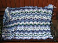 My ripple blanket Rippling Clusters is coming along nicely. I've even made the effort to stitch a few ends in! No pattern yet but I'm working on that. Crochet Ripple Blanket, Ripple Afghan, Kids Blankets, Ravelry, Throw Pillows, Stitch, Projects, Pattern, Effort