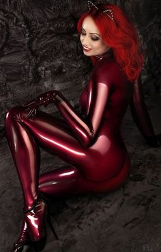Ml 'Red Latex Cat' by Stanislav Istratov. Model: Leyla  MUA & Hair: Liliya Lobanova.  Latex: Agna Devi.  Retouch: Big Bad Red.  www.FlexDreams.com