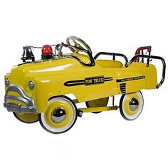 Yellow Deluxe Pedal Tow Truck - I remember the petal cars, but sadly, with a family of only girls, we never had one.  =(