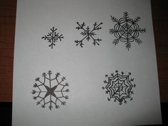 Here is a template I made for piping royal icing into snowflakes.  Hope someone can save themself some time using them.