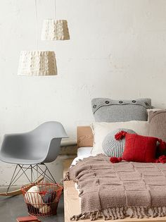 Knit lampshades, a simple platform bed, a mid-century chair, shabby-chic basket for pillow and throw blanket storage...what's not to like?