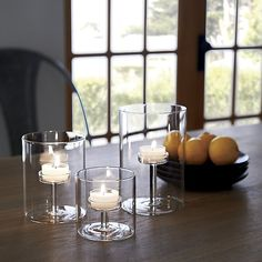 Shop Elsa Large Glass Tea Light Candle Holder.  Interior pedestal raises a single tea light to illuminating heights in Aaron Probyn's clever design that also allows for display of pebbles, seaglass or seasonal seeds and pods.