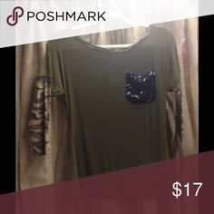 Camo Chic Top You'll LOVE this fabulous top with it's Black Sequin Pocket and Camo Trim Button detail on the back.  3/4 Sleeves in camouflage. Tops Blouses