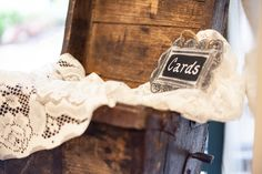 """Antique wooden farm """"scoop"""" with lace drape for cards at gift table"""