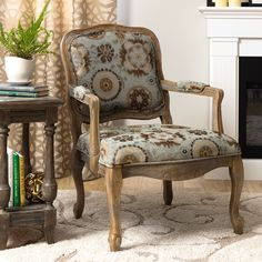 Upgrade the look of your home with this stylish accent chair by Monroe. The natural wood frame is intentionally distressed for an on-trend reclaimed look complemented by 100 percent polyester upholstery in a soft cream, aqua, and brown pattern.