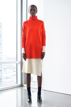 ICB - Fall 2015 Ready-to-Wear -Orange tunic sweater / jumper worn over winter white knit knee-legth skirt or dress.