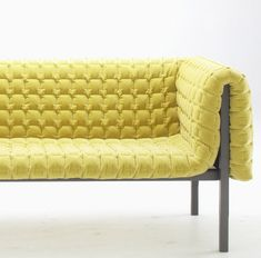 Ruche Settee by Inga Sempe: A slender ray of sunlight in the depths of winter, soft and inviting.