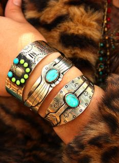 Handmade turquoise and silver cuffs. I love the lime green and turquoise one. Via Junk Gypsy