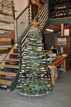 Christmas tree made from books. I saw a picture of one made from colourful books and lights, but I cannot pin it as the photo is on Facebook. If you're interested you can check Knaus Verlag's profile.