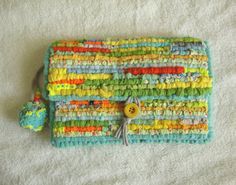 UNIQUE HANDMADE LOCKER HOOKED HAND WOVEN CLUTCH BAG  MADE FROM UP-CYCLED / RECYCLED FABRICS THAT HAVE BEEN LOCKER HOOKED ONTO STRONG LATCH HOOK CANVAS.  COLOURS - MULTI BRIGHT COLOURS, MULTI GLITTER & FLORESCENT 3D FABRIC PAINT, REFLECTIVE HI-VIZ SILVER MATERIALS - UP-CYCLED & RECYCLED COTTON, CHIFFON, LATCH HOOK CANVAS, FABRIC PAINT, FABRIC GLITTER, REFLECTIVE HI VIZ TAPE, FLEECE, HI-VIZ FABRIC, & FELT.     YOU ARE LOOKING AT A STUNNING UNIQUE HAND WOVEN LOCKER HOOKED CLUTCH...