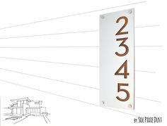 """Modern House Numbers, Alucobond with Varnish Dark Oak Wood- Vertical 2 - Contemporary Home Address -Sign Plaque - Door Number. ✔ SPECIFICATIONS ‾‾‾‾‾‾‾‾‾‾‾‾‾‾‾‾‾‾‾‾‾‾‾‾‾‾‾‾‾‾‾ ❂ The Plaque is made of two layers, one Alucobond and one Acrylic. ❂ Alucobond Sheet 0.12""""- 3 mm ❂ Acrylic 0.12"""" - 3 mm ❂ Both durable for any outside weather ❂ The Plaque has four pre-drilled holes and is supplied with four chrome screws length 1"""" - 25 mm and four Discs Caps 1/2 """"- 13 mm and rawl plugs."""
