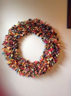 "Fabric scrap wreath using scraps cut 1/2"" wide and 5"" long and tied tightly on all four rings of a 16"" wire wreath."