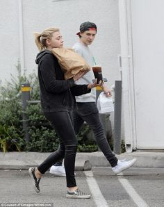 Keeping it casual:Dressed down for the outing, Chloe kept things simple in a black hoodie...