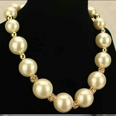 Faux pearl necklace Large faux pearls with gold and rhinestone spacers in between each pearl Jewelry Necklaces