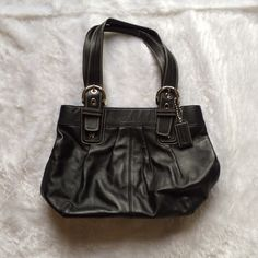Authentic coach leather shoulder bag  Authentic coach black leather shoulder bag  Only carried once  Multi pockets on interior, 13 inches across at top, 15.5 at bottom, 9 inches tall, strap drop 8.5 inches   Please ask for additional pictures, measurements, or ask questions before purchase.  No trades or other apps  Ships next business day, unless noted in my closet   Bundle for discount Coach Bags Shoulder Bags