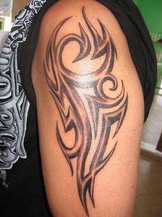 Burbrujita Tribal Arm Tattoo Design - http://tattooideastrend.com/burbrujita-tribal-arm-tattoo-design/ -