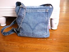 denim purse - love how they used the waist band as the strap.