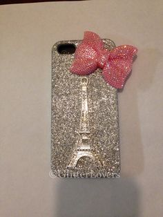 Handmade silver fine glitter iPhone 5 case with a crystal Eiffel Tower and a pink bling bow in the corner.Glitter is sealed to prevent shedding ?case can be made for iPhone iPod 4 or galaxy also. Girly Phone Cases, Iphone Cases For Girls, Iphone Cases Disney, Iphone Cases Cute, Cute Cases, Ipod Cases, Ipod 5, Iphone 4s, Phone Covers