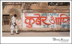 A man walks past a bright red graffitti wall Varanasi, India Walk On, People Leave, Varanasi, Incredible India, Dory, The Incredibles, Canvas, Prints, Tela