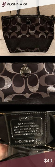 Authentic Coach Purse Black and silver authentic Coach Purse last picture shows the straps the leather is starting to peel off, other than that the purse is in excellent condition Coach Bags