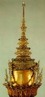 The Crown of Victory     Buddhist regalia is blessed by the priesthood and thus considered as holy objects, to be worn by the semi divine Kings. This crown, made of gold and set with precious stones was worn by King Bumihbol of Thailand, for his coronation in the early 1950's. Thailand also boasts a Prince's Crown.        Buddhist regalia is blessed by the priesthood and thus considered as holy objects, to be worn by the semi divine Kin...