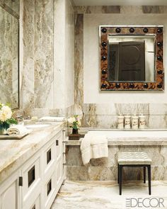 Room to Grow. The master bath is sheathed in marble with Venetian-plaster insets; the sink fittings are by Sherle Wagner, and the 1960s mirror is made of polished nickel and coconut shells.  Read more: Steven Gambrel Renovates a Manhattan