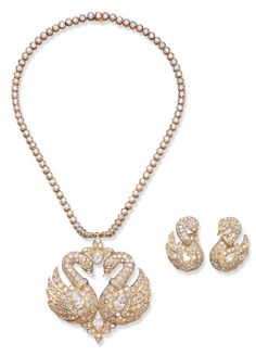 A SET OF DIAMOND JEWELLERY, BY GRAFF  Comprising a pendent necklace, the detachable pendant designed as twin pavé-set and pear-shaped diamond swans, joined by circular-cut and pear-shaped floral motif panels, to the collet-set neckchain; and a pair of ear clips en suite, mounted in 18k gold