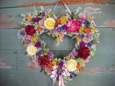 Bright spring garden dried flower heart wreath. For your Valentine or home.. $29.00, via Etsy.
