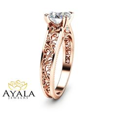Make a lasting impression with this antique Design moissanite engagement ring from Ayala Jewelry. Meticulously handcrafted and forged in designer detail, it is a fascinating art deco ring for women of all ages. The band is made from solid 14K Rose gold. A large forever Brilliant moissanite adorns the top as a trellis of filigree accents cascade downwards from either side. It is an heirloom quality engagement ring that is sure to become a precious family heirloom. This is a limited edition…