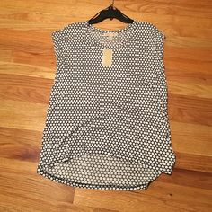 NWT, Michael Kors Black & White Dot Top Brand new with tags never worn, short sleeve, all Vicose material. Black and white, authentic Michael Kors Tops Blouses