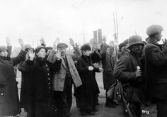 """German troops in Finland during the Finnish Civil War, part of a series of conflicts spurred on by World War I. Red troops, both men and women, ready for deportation from Hango, in April of 1918. Two main groups, """"Reds"""" and """"Whites"""" were battling for control of Finland, with the Whites gaining the upper hand in April of 1918, helped by thousands of German soldiers. (National Archive/Official German Photograph of WWI) #"""