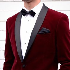 red velvet tuxedo and a bow tie