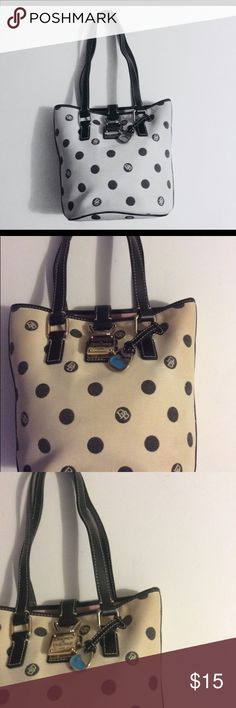 """Dooney & Bourke Handbag In good condition. Spacious bucket styled Handbag. There's light blemish on the canvas.The color of this canvas material is """"off white"""" . H9""""XL11""""X5""""strap drop10"""". Dooney & Bourke Bags Totes"""