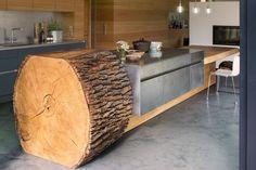 Eine Küche wie ein Baum mit BORA Kochfeldabzug Der rustikale Hingucker hat mit Edelstahl und dem Sichtestrich ruhige, kühle Gegenspieler. Möglich macht solch ein außergewöhnliches Küchendesign der BORA Kochfeldabzug nach unten…
